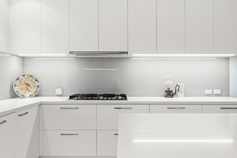 Aspendale Gardens-Kitchen renovation Sleek glass splash back with LED lighting strip.