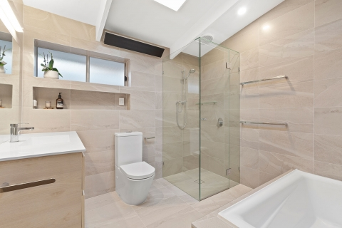 Cheltenham-Main bathroom. We extended the room to incorporate a toilet into the space. Sleek wall mounted strip heater to warm up the winter mornings